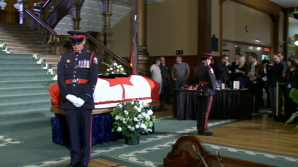 The casket carrying former Ontario lieutenant-governor Lincoln Alexander lies in state at Queen's Park in Toronto on Sunday, Oct. 21, 2012.