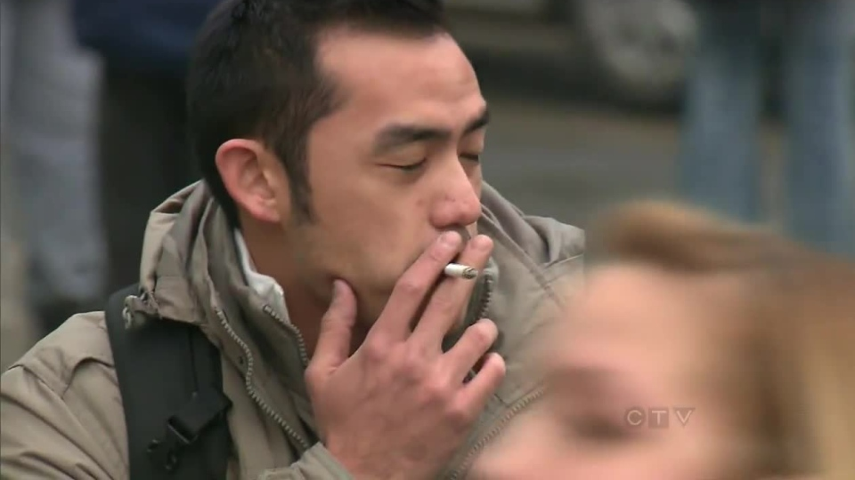 A male is pictured smoking in Toronto on Oct. 22, 2012.