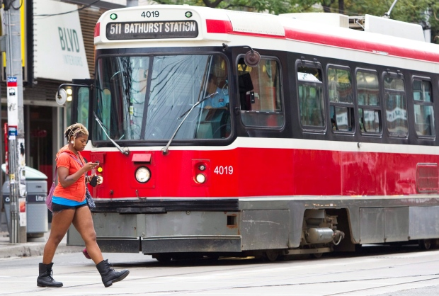 Pedestrian on mobile phone near TTC streetcar