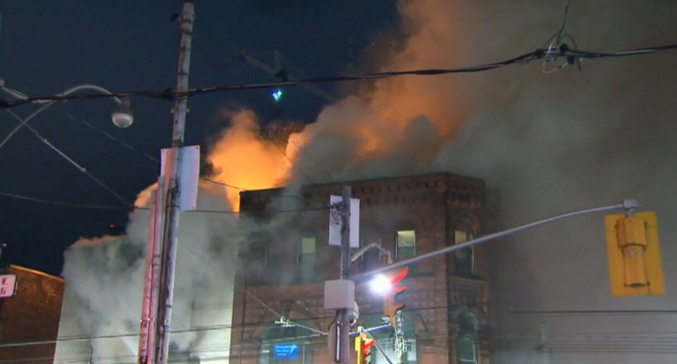 Firefighters put out the massive blaze that consumed the building above the Roots store on Queen St. West on Tuesday, Oct. 30, 2012.