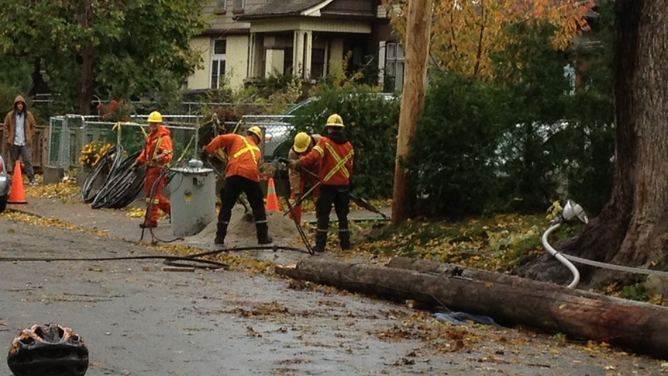 Hydro crews work to repair the damage caused by Hurricane Sandy's high winds on Tuesday, Oct. 30, 2012. (Byron Auburn / CTV News)