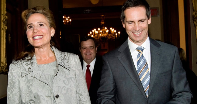 Ontario's Premier Dalton McGuinty, right, smiles with Sandra Pupatello. (Nathan Denette / THE CANADIAN PRESS)