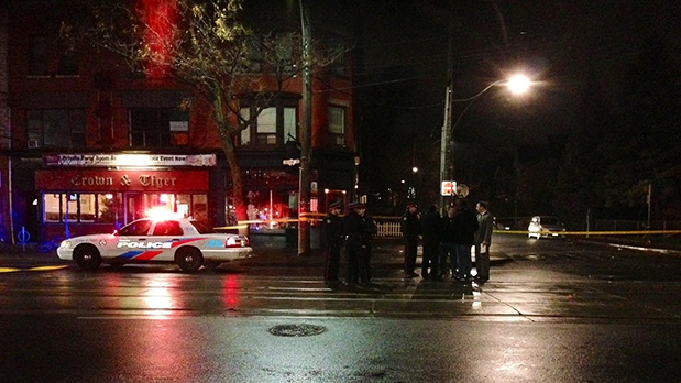 Police gather at the scene of a shooting on College Street in Toronto. (Tom Podolec / CTV Toronto)
