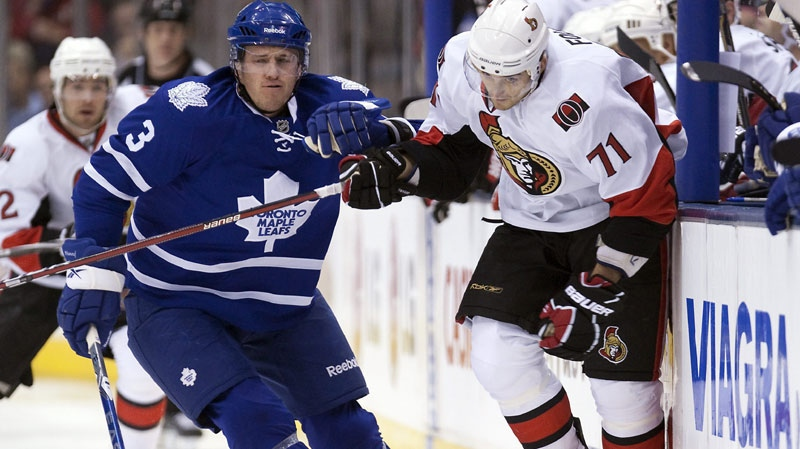 Toronto Maple Leafs defenceman Dion Phaneuf (3) rides Ottawa Senators left winger Nick Foligno (71) into the boards during first period NHL hockey action in Toronto on Tuesday November 2, 2010. (THE CANADIAN PRESS/Frank Gunn)