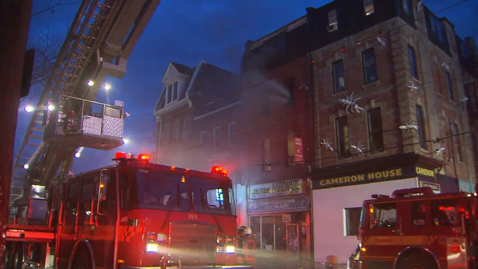 Firefighters battle a blaze on Queen Street West in Toronto early Monday morning.
