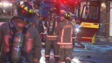 Firefighters battle a blaze on Queen Street West