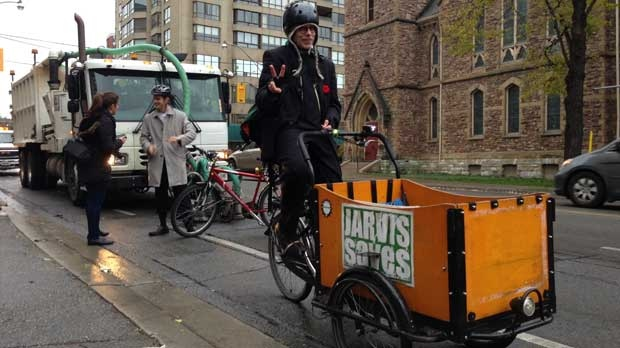 A protester rides along Jarvis Street on November 12, 2012 as city crews prepared to remove bike lanes on the street. (Mathew Reid/CP24)