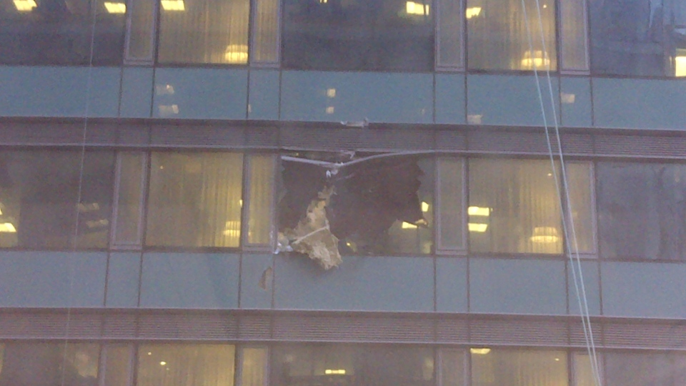 A broken window of the Trump International Hotel & Tower in Toronto is pictured. Police say the glass from the window fell onto several cars below on Wednesday, Nov. 14, 2012. (John Garner for CTV Toronto)