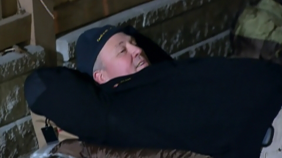 Toronto Police Chief Bill Blair sleeps outside on Nov. 15 as part of an initiative to raise awareness about the plight of homeless youth in downtown Toronto. (CTV)