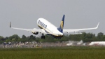An aircraft by Ryanair takes off at the airport in Bremen, northern Germany on May 10, 2009. (AP / Joerg Sarbach)