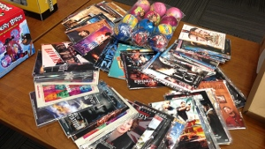 DVDs and other products are laid out on a table at the Toronto Police Services headquarters on Dec. 3, 2012. (Keith Hanley / CTV Toronto)