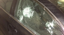 Parked car with a smashed window
