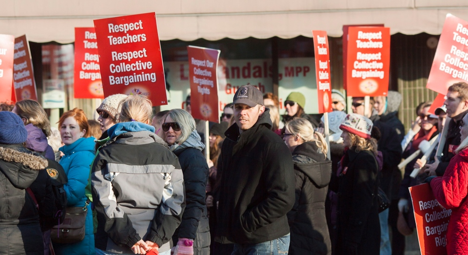 Teachers stage protests against Bill 115 in this file photo.