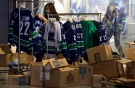An employee at the Vancouver Canucks store unpacks merchandise at Rogers Arena Friday, May 27, 2011. (Jonathan Hayward / THE CANADIAN PRESS)