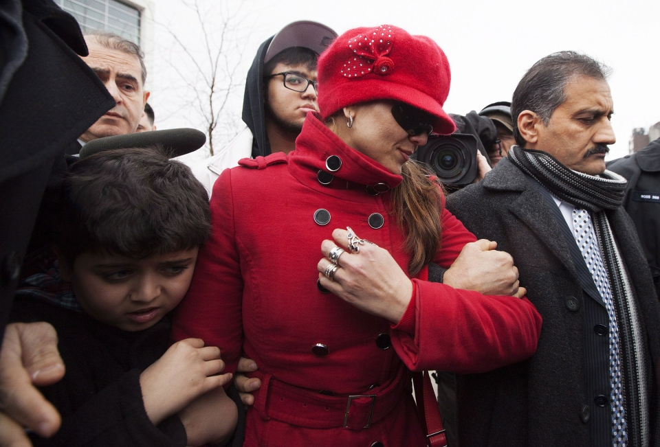 Yasmin Nakhuda links arms with her husband and 11-year-old son as she leaves an Oshawa courthouse on Friday, December 21, 2012 after she was denied custody of her famed monkey Darwin. (Michelle Siu / THE CANADIAN PRESS)
