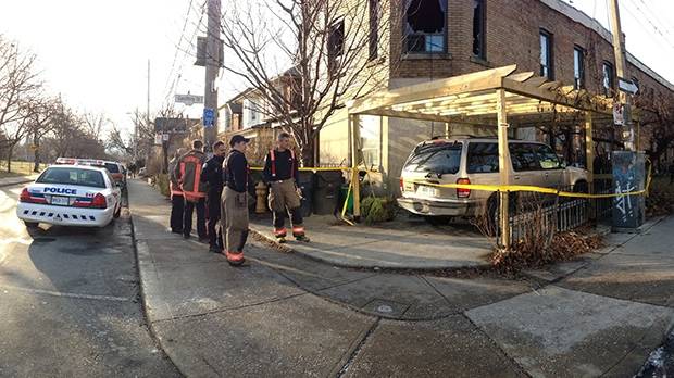 A building on Sorauren Avenue is cordoned off after a fatal fire on Dec. 23, 2012. (Colin D'Mello / CTV Toronto)