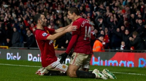 Manchester United's Javier Hernandez, right, celebrates with teammate Ryan Giggs after scoring against Newcastle United during their English Premier League soccer match at Old Trafford Stadium, Manchester, England, Wednesday Dec. 26, 2012. (AP Photo/Jon Super)