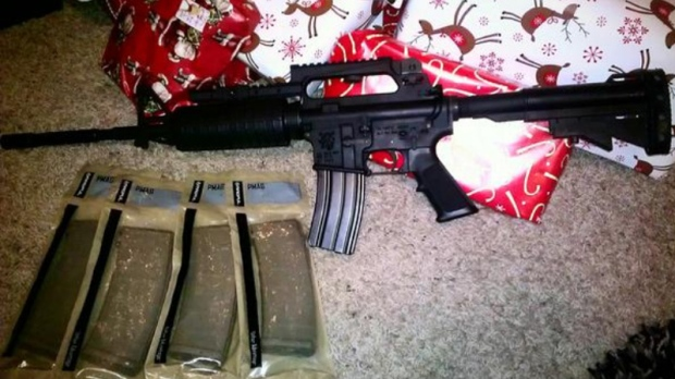 Owner pose with guns they got for Christmas