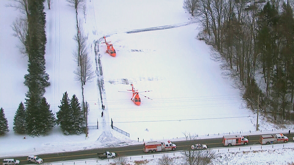 A pair of air ambulances are shown after arriving at the scene of a serious head-on collision in East Gwillimbury, Ont. Thursday, Dec. 27, 2012.