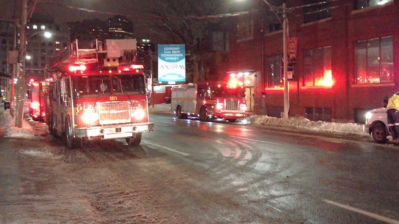 An early morning fire breaks out at a condo and leaves one man dead in Toronto, Friday, Dec. 28, 2012.