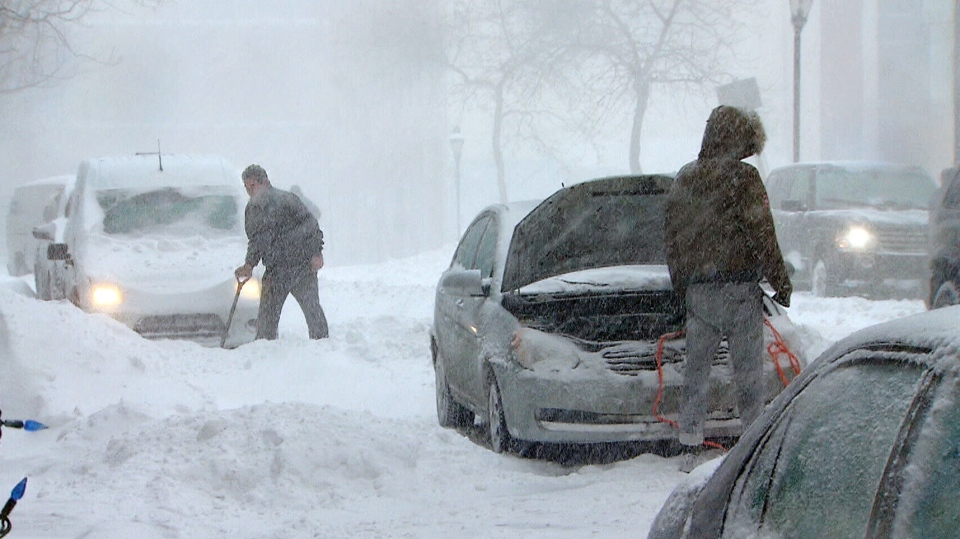 Ottawa residents dig their way out of a snowstorm Friday, Dec. 28, 2012.