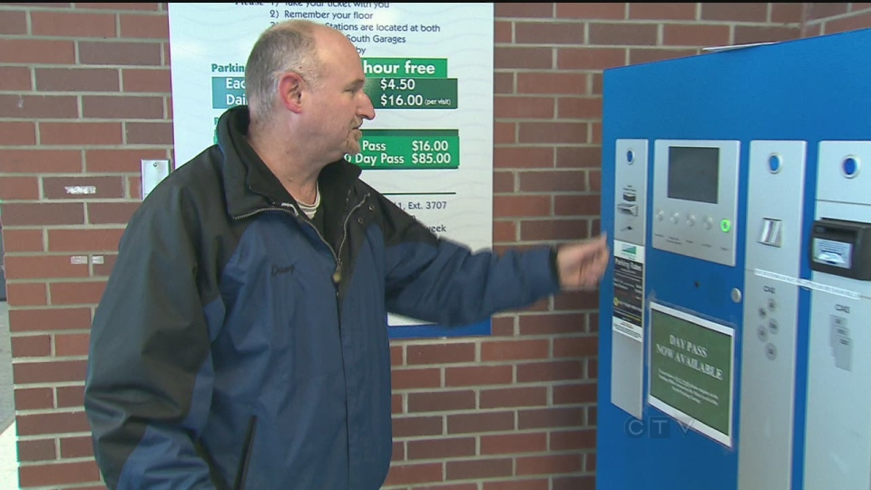 Oshawa Councillor Doug Sanders pays for parking at a hospital in Oshawa, Friday, Dec. 28, 2012.
