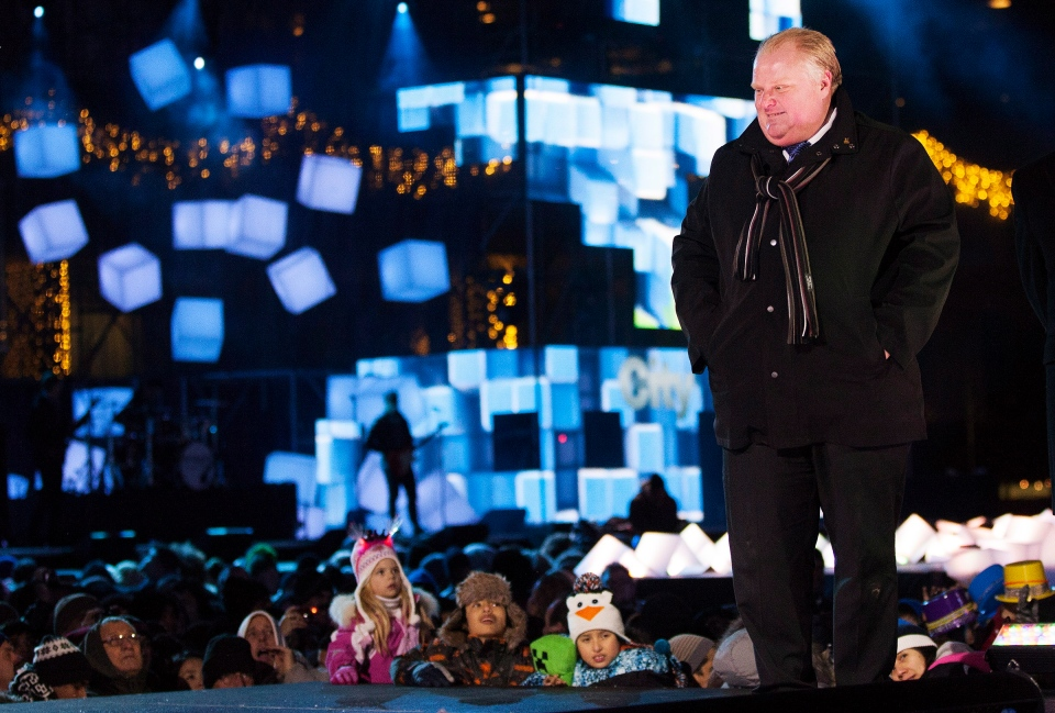 Toronto Mayor Rob Ford briefly takes the stage to greet the crowd as part of the New Year's Eve celebrations at Nathan Phillips Square in Toronto on Monday, December 31, 2012. (Michelle Siu / THE CANADIAN PRESS)