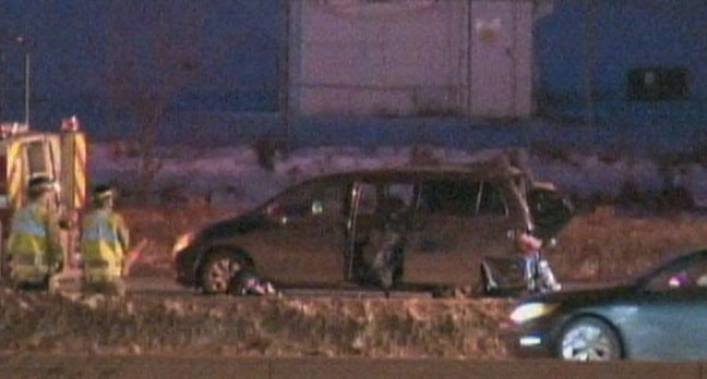 A van involved in a fatal collision on Highway 401 near Dixie Road is shown. Police say a seven-year-old boy died after a Hummer struck the van and then fled the scene Tuesday, Jan. 1, 2013.