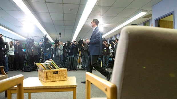 Ontario Premier Dalton McGuinty arrives at a press conference at St. Fidelis Catholic Elementary School in Toronto on Thursday, Dec. 20, 2012. (Chris Young / The Canadian Press)