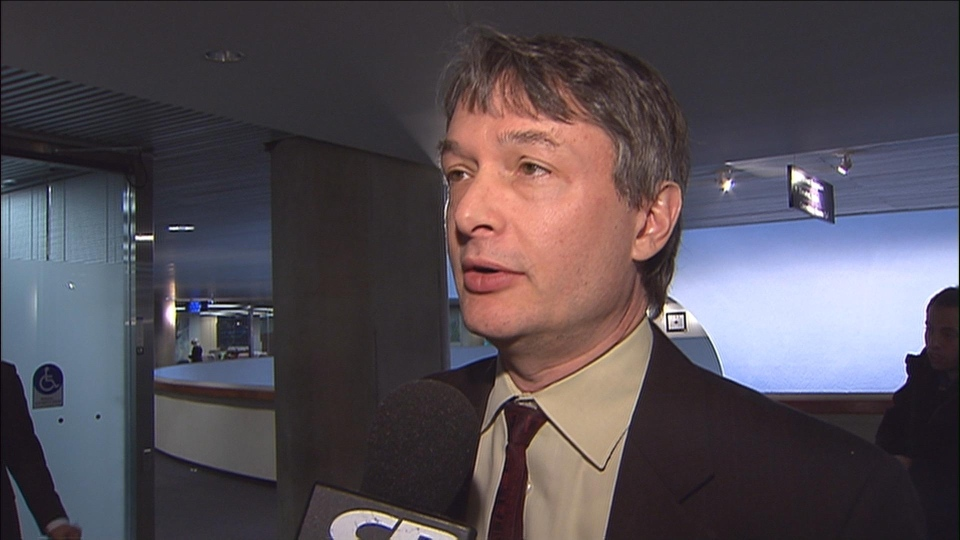 Councillor Gord Perks reacts to discussion about the 2013 budget at Toronto City Hall January 8, 2013.