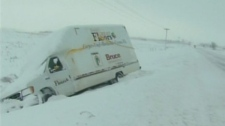 A vehicle is seen in the ditch on Highway 402 during a snow storm near Sarnia, Monday, Dec. 13, 2010.