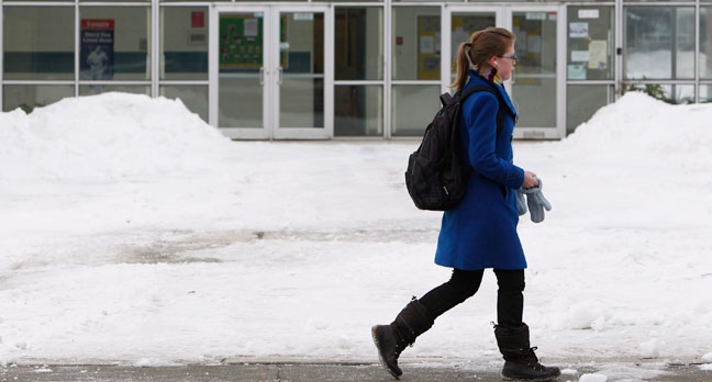 A student walks by Hawthorne Public School in Ottawa as Ontario public schools remained opened Friday, Jan. 11, 2013. (Cole Burston / THE CANADIAN PRESS)