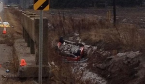 A vehicle involved in a fatal accident in Alliston, Ontario sits in a ditch on Sunday, January 13, 2013. (Heather Wright)
