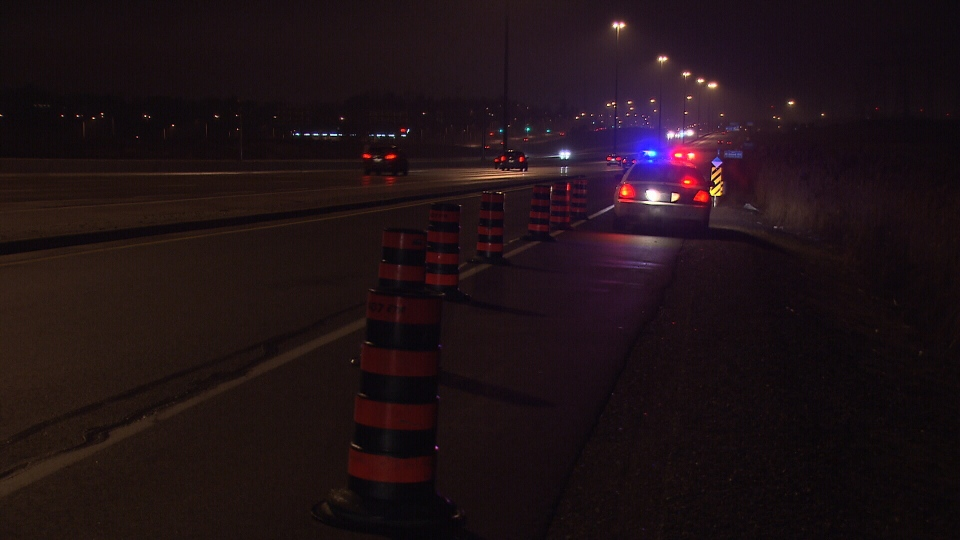 York Regional Police at the scene where a human skull was found on a highway ramp in Vaughan, Ont., Sunday, Jan. 13, 2013.