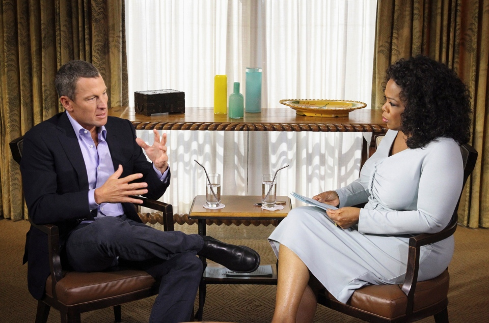 This photo provided by Harpo Studios Inc., shows talk-show host Oprah Winfrey interviewing cyclist Lance Armstrong during taping for the show