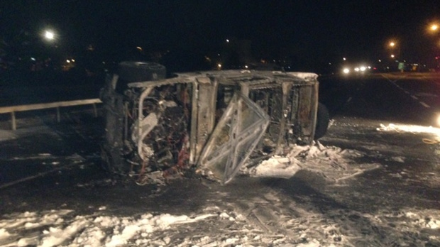 A 43-year-old woman was killed in a fiery crash on Highway 400 in Barrie early Wednesday, Jan. 16, 2013. (Cam Woolley/CP24)