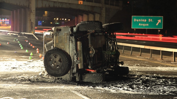 A 43-year-old woman was killed in a fiery crash on Highway 400 in Barrie early Wednesday, Jan. 16, 2013. (Tom Stefanac/CTV Toronto)