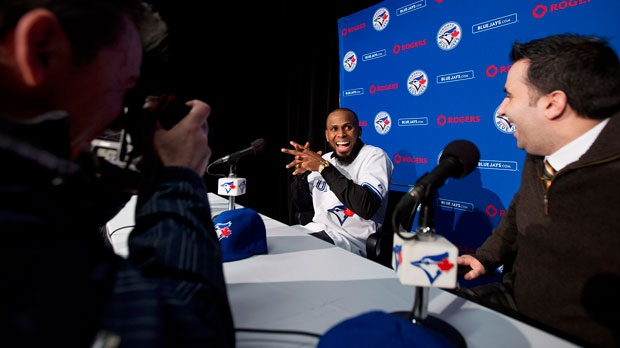 New Toronto Blue Jay shortstop Jose Reyes shows his excitement with General Manager Alex Anthopoulos, right, at a Toronto Blue Jays press conference in Toronto on Thursday, Jan. 17, 2013. (The Canadian Press/Aaron Vincent Elkaim)
