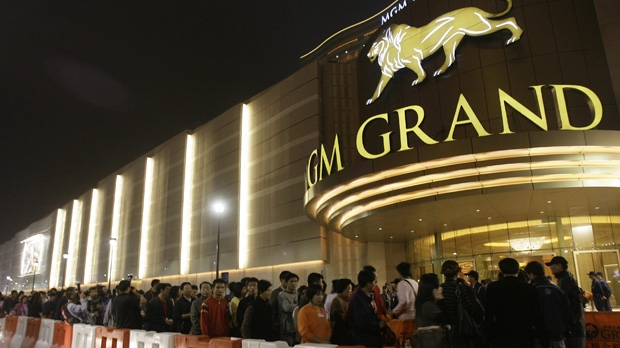 In this Dec. 18, 2007, file photo, visitors line up to enter the MGM Grand Macau resort casino after the opening ceremony. (AP Photo/Vincent Yu, File)