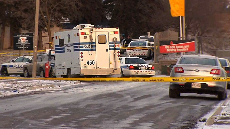 Police investigate the scene where a 9-year-old boy was shot in Brampton, Ont., on Thursday, Jan. 24, 2013.