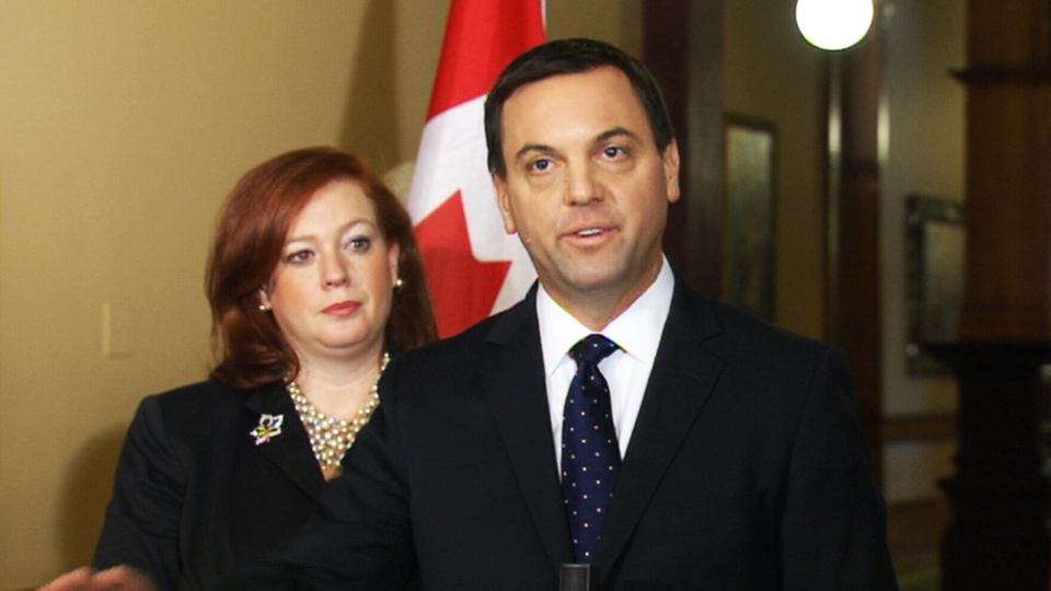 Ontario PC leader Tim Hudak speaks in front of the Toronto District School Board offices in Toronto on Thursday, Jan. 24, 2013.