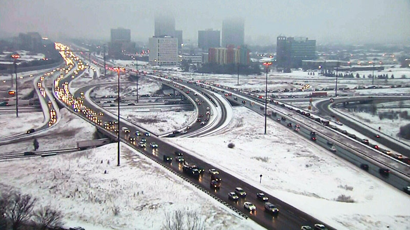 Drivers had a slow commute early morning due to snow and freezing rain, Monday, Jan. 28, 2013.