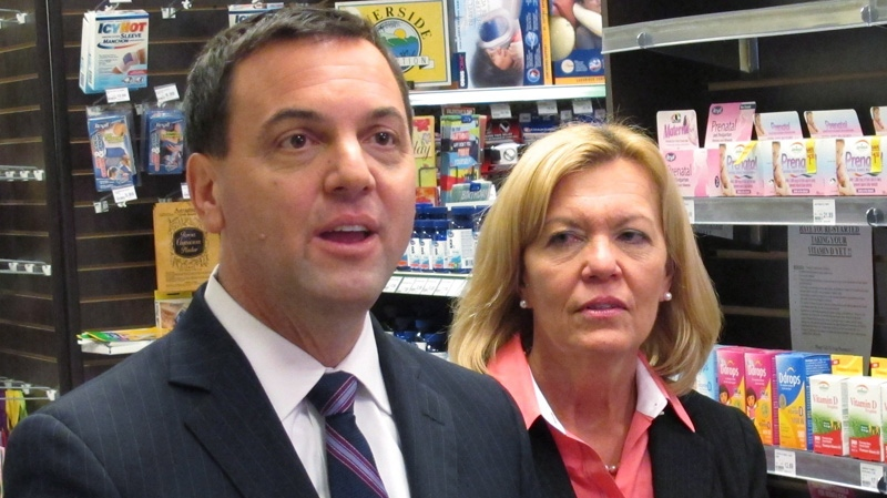 Ontario Progressive Conservative Leader Tim Hudak is seen with his deputy, Christine Elliott, at a pharmacy in Toronto on Tuesday, Jan. 29, 2013. (THE CANADIAN PRESS / Colin Perkel)
