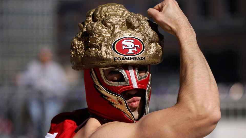 A San Francisco 49ers fan poses for photos before the NFL Super Bowl XLVII football game between the 49ers and the Baltimore Ravens in New Orleans on Sunday, Feb. 3, 2013. (AP / Mark Humphrey)