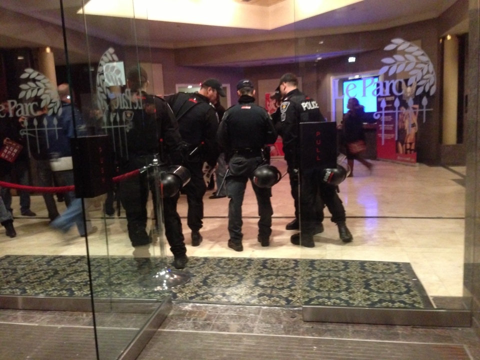 Members of the Combined Forces Special Enforcement Unit (CFSEU) execute a search warrant at the LE PARC Banquet and Concert Centre at Highway 7 and Leslie Street Sunday, Feb. 3, 2013. (Tom Podolec / CTV News)