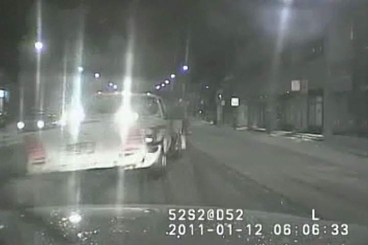 A snowplow is shown closing in on Sgt. Ryan Russell's police vehicle in this still photo taken from video from the cruiser front dashboard. The video was released Wednesday at the trial of trial of Richard Kachkar who has pleaded not guilty to charges of first-degree murder and dangerous driving in Russell's death. (HO / THE CANADIAN PRESS)