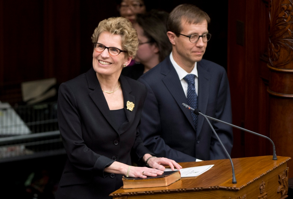 Kathleen Wynne smiles as she is sworn-in as Ontario premier at Queen's Park in Toronto on Monday, Feb. 11, 2013. (Frank Gunn / THE CANADIAN PRESS)