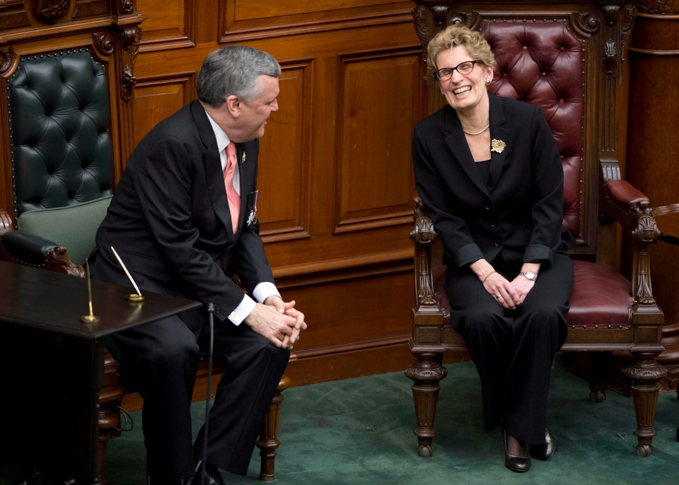 Ontario Premier Kathleen Wynne shares a laugh with Ontario Lt.-Gov. David Onley during her swearing in ceremony in Toronto on Monday, Feb. 11, 2013. (Frank Gunn / THE CANADIAN PRESS)