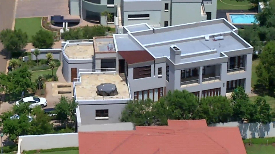 This aerial image taken from video provided by VNS24/7 on Thursday, Feb. 14, 2013, shows the home of Olympic athlete Oscar Pistorius in a gated housing complex in Pretoria, South Africa. (AP Photo/VNS24/7)