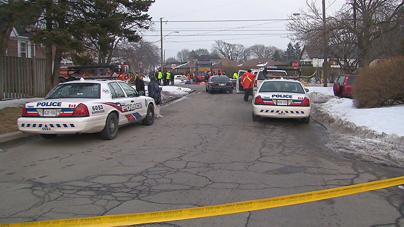 Police investigate after a young girl was fatally struck by a garbage truck in Toronto, Thursday, March 7, 2013.
